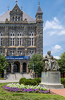 Georgetown University, Statue of John Carroll, Founder of the University, Washington, DC., USA. Healy Hall in Background.