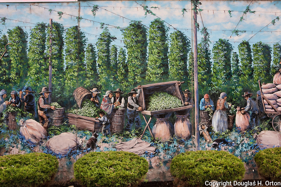 Partial view of mural When Hops Were Picked by Hand.  Toppenish, the City of Murals, in Washington State's Yakima Valley, with 300 days of sunshine per year sports some of the finest vineyards in the state.  Rattlesnake Hills AVA shares hillsides and valley with traditional orchard crops.