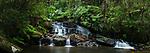 Sacred waterfall on Piste Ranasoa. Mid-altitude rain forest stream. Andasibe-Mantadia National Park, eastern Madagascar.
