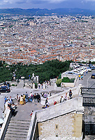 Tourists looking out over the cityscape from Notre Dame de la Garde, Marseille, France.
