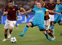 Calcio, Champions League, Gruppo E: Roma vs Barcellona. Roma, stadio Olimpico, 16 settembre 2015.<br /> FC Barcelona's Andres Iniesta, right, is challenged by Roma's Kostas Manolas, during a Champions League, Group E football match between Roma and FC Barcelona, at Rome's Olympic stadium, 16 September 2015.<br /> UPDATE IMAGES PRESS/Isabella Bonotto
