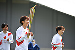 Azusa Iwashimizu and members of Japan's 2011 World Cup winning women's football team participate in the Tokyo 2020 Olympic Torch Relay at Fukushima National Training Center J-Village on March 25, 2021, in Fukushima Prefecture, Japan.<br /> The Torch Relay will last 121 days and visit all of Japan's 47 prefectures. (Photo by MATSUO.K/AFLO SPORT)