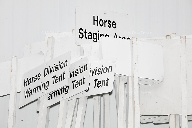 Signs for the police horse division warming tent and horse staging area stand ready as people gather in the National Mall area of Washington, DC, for the Women's March on Washington protest and demonstration in opposition to newly inaugurated President Donald Trump on Jan. 21, 2017.