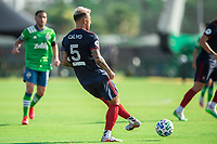 LAKE BUENA VISTA, FL - JULY 14: Francisco Calvo #5 of the Chicago Fire kicks the ball during a game between Seattle Sounders FC and Chicago Fire at Wide World of Sports on July 14, 2020 in Lake Buena Vista, Florida.