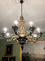 BNPS.co.uk (01202) 558833. <br /> Pic: Duke's/BNPS<br /> <br /> Pictured: This regence style gilt bronze eight light chandelier, from the dining room of Wormington Grange, has an estimate of £25,000. <br /> <br /> The lavish contents of one of Britain's most beautiful stately homes are being auctioned off in a £1m everything must go sale.<br /> <br /> Wormington Grange has been owned since the 1970s by John Evetts, the grandson of Lord Ismay, Winston Churchill's chief military strategist during World War Two.<br /> <br /> Mr Evetts has sold the £15m neoclassical Cotswolds mansion as he is downsizing to a smaller property in the area.<br /> <br /> The sale, to be conducted by Duke's, of Dorchester, Dorset, features over 1,000 items ranging in value from £50 kitchen glasses to £100,000 works of art.