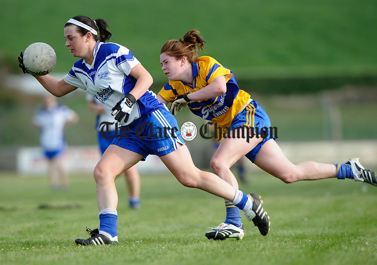 West Clare Gael's Maria Kelly is tackled by Louise Woods of The Banner  during the Ladies Football Division 1 final at Quilty. Photograph by John Kelly.