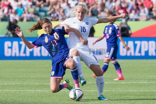 England's midfielder Katie Chapman (16) and Japan's midfielder Rumi Utsugi (13) fight for the ball during second half of a Women's World Cup semifinal match, Wednesday July 01, 2015 in Edmonton, Alberta. (Mo Khursheed/TFV Media via AP Images) MANDATORY CREDIT