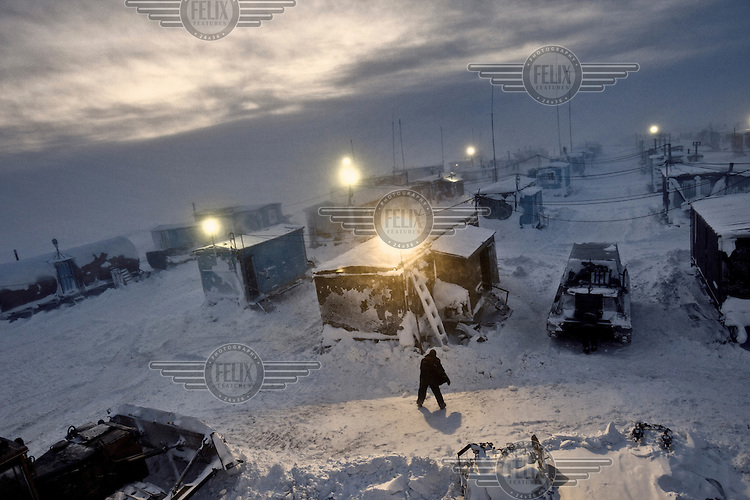 A man working for the oil and gas prospecting company Siesmorevzedka braves a snowstorm at a camp in the Arctic tundra. /Felix Features