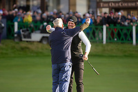 3rd October 2021; The Old Course, St Andrews Links, Fife, Scotland; European Tour, Alfred Dunhill Links Championship, Fourth round; Danny Willett of England celebrates with his amateur partner, American investment banker and philanthropist Jimmy Dunne, on the 18th green of the Old Course, St Andrews, after winning the Alfred Dunhill Links Championship