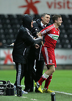 Wednesday, 12 December 2012<br /> Pictured: Tony Mowbray manager of Middlesbrough (C) gives his instruction to one of his substitute players<br /> Re: Capital One Cup, fifth round, Swansea City FC v Middlesbrough at the Liberty Stadium, south Wales.