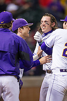 LSU Tigers third baseman Conner Hale (20) celebrates with Kramer Robertson (3) after belting a 2 run home run during the NCAA baseball game against the Houston Cougars on March 6, 2015 at Minute Maid Park in Houston, Texas. LSU defeated Houston 4-2. (Andrew Woolley/Four Seam Images)