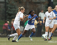 Duke University midfielder Toni Payne (10) dribbles as Boston College midfielder Kate McCarthy (21) defends.Boston College (white) defeated Duke University (blue/white), 4-1, at Newton Campus Field, on October 6, 2013.