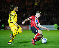 Lincoln City's Conor Coventry vies for possession with Milton Keynes Dons' David Kasumu<br /> <br /> Photographer Andrew Vaughan/CameraSport<br /> <br /> The EFL Sky Bet League One - Lincoln City v Milton Keynes Dons - Tuesday 11th February 2020 - LNER Stadium - Lincoln<br /> <br /> World Copyright © 2020 CameraSport. All rights reserved. 43 Linden Ave. Countesthorpe. Leicester. England. LE8 5PG - Tel: +44 (0) 116 277 4147 - admin@camerasport.com - www.camerasport.com