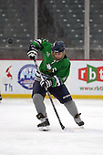 Notre Dame Fighting Irish of Batavia defensemen Kris Bank (14) during a varsity ice hockey game against the Brockport Blue Devils during the Section V Rivalry portion of the Frozen Frontier outdoor hockey event at Frontier Field on December 22, 2013 in Rochester, New York.  (Copyright Mike Janes Photography)