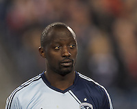 Sporting Kansas City midfielder Lawrence Olum (13). In the first game of two-game aggregate total goals Major League Soccer (MLS) Eastern Conference Semifinal series, New England Revolution (dark blue) vs Sporting Kansas City (light blue), 2-1, at Gillette Stadium on November 2, 2013.