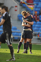 Lauren Cheney hugs Abby Wambach as German goalie Nadine Angerer walks back to her goal after Cheney scored what was the game winning goal vs Germany in the 2010 Algarve Cup final in Faro, Portugal. USA won 3-2.