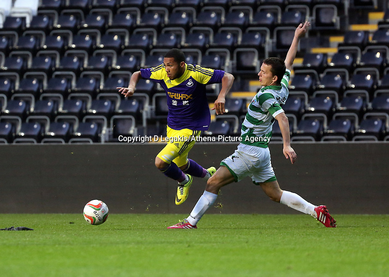 Thursday, 16 April 2014<br /> Pictured L-R: Kenji Gorre of Swansea avoids a tackle by a TNS player. <br /> Re: FAW Youth Cup Final, Swansea City FC v The New Saints FC at the Liberty Stadium, south Wales,
