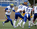 BROOKINGS, SD - MAY 8: Nolan Henderson #2 of the Delaware Fightin Blue Hens hands the ball off to teammate Dejoun Lee #33 against the South Dakota State Jackrabbits on May 8, 2021 in Brookings, South Dakota. (Photo by Dave Eggen/Inertia)