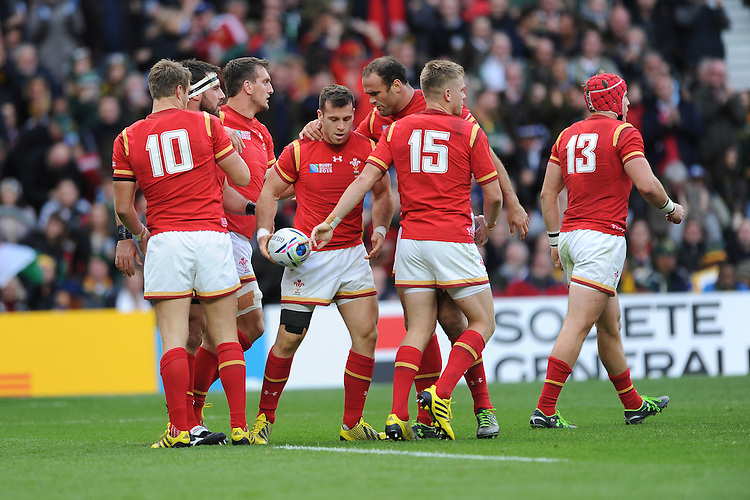 Gareth Davies of Wales is congratulated by Jamie Roberts and team mates after scoring a try during Match 41 of the Rugby World Cup 2015 between South Africa and Wales - 17/10/2015 - Twickenham Stadium, London<br /> Mandatory Credit: Rob Munro/Stewart Communications
