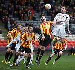 Ryan Stevenson heads in the third goal for Hearts