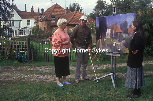 Elizabeth Jane Howard author in her garden Bungay Suffolk UK with blind artist Sargy Mann and his wife.1995  1990s UK