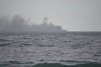 RIO DE JANEIRO-01 DE AGOSTO DE 2012-Um navio pegando fogo na orla do rio, em Copacabana, zona sul do rio nesta quarta feira, 01 de agosto.(FOTO:MARCELO FONSECA/BRAZILPHOTOPRESS