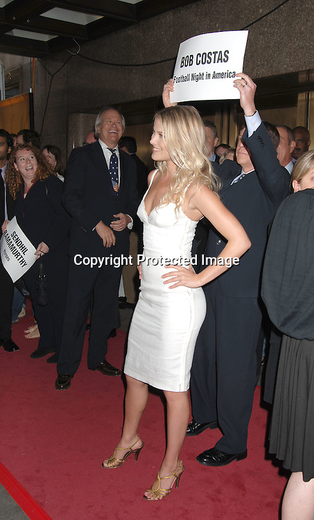 Ali Larter and Bob Costas behind her..arriving for The NBC Upfront announcement of their Fall 2006-2007 Schedule on May 15, 2006 at Radio City Music ..Hall...Robin Platzer, Twin Images