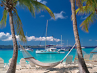 Boats and hammock at Jost Van Dyke. British Virgin Islands
