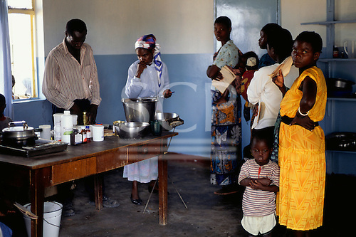Mbati, Zambia, Africa. Health clinic with people waiting for medication and vaccinations.