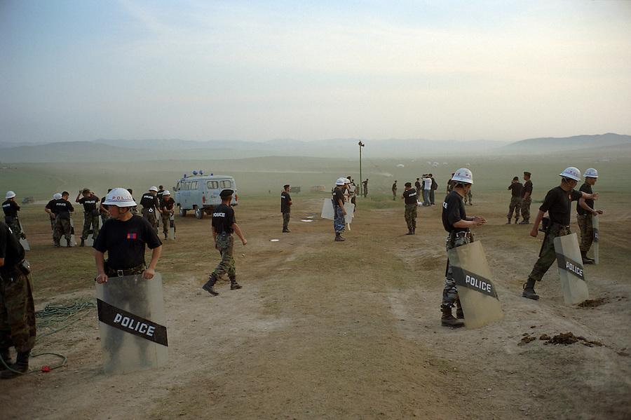 Khui Doloon Khudag, Mongolia, July 2003..Competitors & spectators at the horse racing in the national Naadam 40 kilometres outside Ulaanbaatar..Riot police assemble on the steppes in the early morning before racing begins.