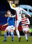 St Johnstone v Hamilton Accies…30.12.20   McDiarmid Park     SPFL<br />Liam Craig triesnto avoid a high boot from Ben Stirling<br />Picture by Graeme Hart.<br />Copyright Perthshire Picture Agency<br />Tel: 01738 623350  Mobile: 07990 594431