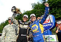 Jun. 17, 2012; Bristol, TN, USA: NHRA top fuel dragster driver Tony Schumacher (left) celebrates with teammate Ron Capps after winning the Thunder Valley Nationals at Bristol Dragway. Mandatory Credit: Mark J. Rebilas-