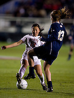 Danica Wu (19) of Ohio State fights for the ball with Courtney Barg (13) of Notre Dame during the first game of the NCAA Women's College Cup at WakeMed Soccer Park in Cary, NC.  Notre Dame defeated Ohio State, 1-0.
