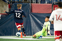 FOXBOROUGH, MA - OCTOBER 16: Carlos Avilez #1 of North Texas SC slides to intercept a ball near the North Texas goal during a game between North Texas SC and New England Revolution II at Gillette Stadium on October 16, 2020 in Foxborough, Massachusetts.