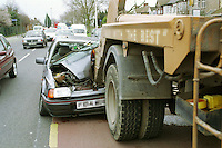 Road traffic accident involving a car and a skip lorry. The driver of the car tried to avoid heavy traffic by driving down a bus lane and dove straight into the back of the stationary heavy goods vehicle and was crushed underits rear wheels. The dashboard, windscreen, roof, bonnet and engine were completely destroyed. The accident caused severe tailbacks and traffic jams. Paramedic ambulances and traffic police are in attendance...© SHOUT. THIS PICTURE MUST ONLY BE USED TO ILLUSTRATE THE EMERGENCY SERVICES IN A POSITIVE MANNER. CONTACT JOHN CALLAN. Exact date unknown.john@shoutpictures.com.www.shoutpictures.com.