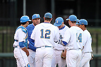 John Savage #22, Head Coach of the UCLA Bruins, talks to his team during game against the Oregon State Beavers at Jackie Robinson Stadium in Los Angeles,California on April 29, 2011. Photo by Larry Goren/Four Seam Images