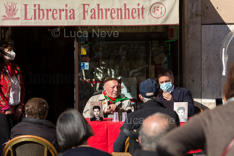 "Rome, Italy. 25th Apr, 2021. Today, to mark the 76th Anniversary of the Italian Liberation from nazi-fascism the Fahrenheit 451 Bookshop (Libreria Fahrenheit 451, Piazza Campo De' Fiori 44, Rome, 1.), co-organised with ANPI Roma Centro (National Association of WWII Italian Partizans, 2.) the presentation of the book ""Umberto Graziani Un Partigiano Abruzzese Nella Brigata Rab"" (Umberto Graziani A Partizan From Abruzzo In The Rab Brigade, D'Abruzzo Edizioni Menabò, 3.) written by Roberto Delle Cese. The event was hosted by the author of the book who held a public conversation with the Partizan Umberto Graziani. From the Facebook event page (4.): «[…] With an original and authentic language, the memories of the partisan Umberto Graziani (born in 1923), originally from Vestea, a fraction of the municipality of Civitella Casanova in the province of Pescara, a detailed account of the fascist internment camp of Kampor, on the island of Arbe in Croatia and the events linked to the Yugoslav Resistance in which Italian partisans also participated. In the testimony Graziani recounts the years of his youth in Abruzzo, focusing on the circumstances that led him to mature the choice to become a partisan. The decision to fight for a better future, characterized by the ideals of justice and freedom, was the result of a political conscience matured as a boy during fascism and subsequently developed during the war period. On the basis of an extensive bibliography, the introductions by Gianni Orecchioni and the author place Graziani's memoirs in the complex context of the years 1941-44 in the region of the former Yugoslavia […]».<br />