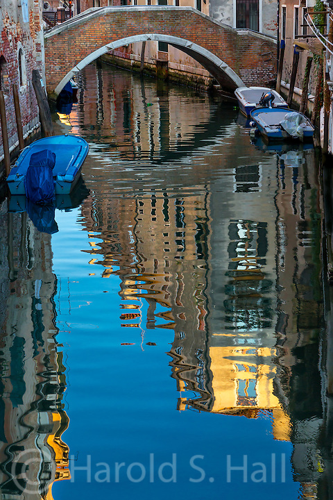 Street parking along the canals of Venice, Italy.  All bridges across the canals have numerous steps up and down to allow the boats and gondolas to pass underneath.  At high tide, the gondolas may still scratch the underside of the bridges.