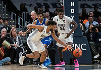 WASHINGTON, DC - FEBRUARY 05: Jagan Mosely #4 of Georgetown moves the ball up court during a game between Seton Hall and Georgetown at Capital One Arena on February 05, 2020 in Washington, DC.