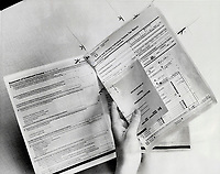 First thing for novice tax-filers to do is remove tax booklet's centre section - that's the actual return; with an envelope you use for mailing the return.<br /> <br /> Bezant, Graham<br /> Picture, 1978,<br /> <br /> 1978<br /> <br /> PHOTO : Graham Bezant - Toronto Star Archives - AQP
