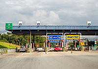 Malaysia.  Approaching Toll Booth on Highway AH2 between Ipoh and Taiping.