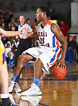 Texas-Arlington Mavericks guard Cameron Catlett (25) dribbles the ball in the game between the UTA Mavericks and the Hardin-Simmons Cowboys held at the University of Texas in Arlington's Texas Hall in Arlington, Texas. UTA defeats Hardin-Simmons 88 to 71.