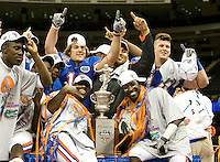 01 January 2010:  Florida players pose together for group photo with the Sugar Bowl Champion Trophy after the game against Cincinnati during Sugar Bowl at the SuperDome in New Orleans, Louisiana.  Florida defeated Cincinnati, 51-24.