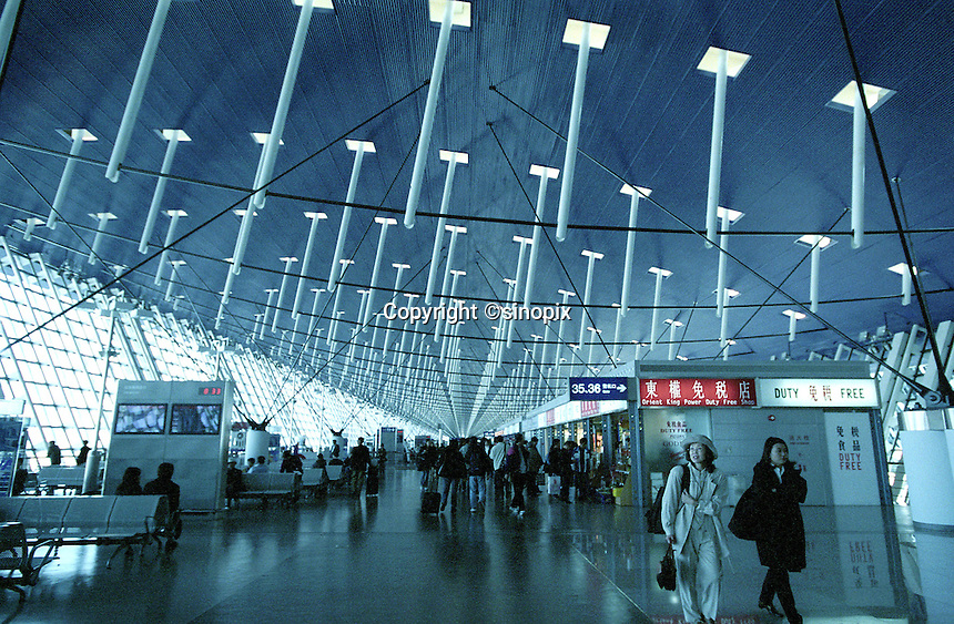 People shopping at the duty free shops inside Shanghai Pudong Airport, China..