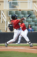 Bryce Bush (25) of the Kannapolis Intimidators follows through on his swing against the Lexington Legends at Kannapolis Intimidators Stadium on May 15, 2019 in Kannapolis, North Carolina. The Legends defeated the Intimidators 4-2. (Brian Westerholt/Four Seam Images)