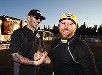 Feb 8, 2015; Pomona, CA, USA; NHRA top fuel driver Shawn Langdon celebrates with crew member Adam Baranski after winning the Winternationals at Auto Club Raceway at Pomona. Mandatory Credit: Mark J. Rebilas-
