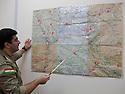 Iraq 2014 <br />     Sirwan Barzani, Peshmerga officer in charge of the 6th branch in Mahmur district, showing on the map the front line <br /> Irak 2014 <br /> Sirwan Barzani, officier de peshmergas, responsable de la 6eme branche region de Mahmur, montrant sur la carte la ligne de front