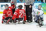 Greg Westlake and Brad Bowden, Vancouver 2010 - Para Ice Hockey // Para-hockey sure glace.<br /> Team Canada plays against Italy in Para Ice Hockey action // Équipe Canada affronte l'Italie dans un match de para-hockey sur glace. 13/03/2010.