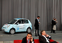 """Electric car and business people at trade fair. Renewable sources will be helping to meet the world's demand for energy in the future. This development opens new markets and opportunities for business. Hoping to make """"green business"""" and """"green profit"""" over 60 exhibitors took part in the The North European Renewable Energy Convention (Nerec) , in Norway, presenting their solutions for renewable energy in the future. .© Fredrik Naumann/Felix Features"""