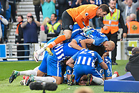 Anthony Knockaert of Brighton & Hove Albion (11) is mobbed by team mates after Scoring his teams first goal of the game during the Premier League match between Brighton and Hove Albion and Everton at the American Express Community Stadium, Brighton and Hove, England on 15 October 2017. Photo by Edward Thomas / PRiME Media Images.